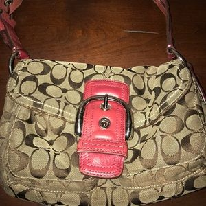 Coach purse with pink handle